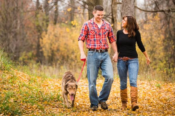 smiling-Retriever, couple-walking-Chesapeake-Bay-retriever-in-woods