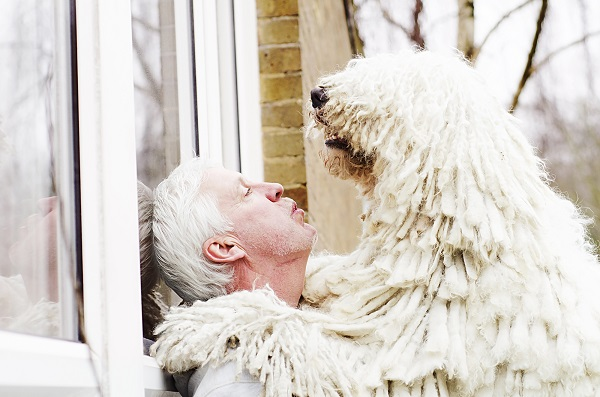 © Amber Allen,  Mrs Mutts London Pet Photography, dog-hug, big-fluffy-dog, Komondor, Crufts-dog-photography