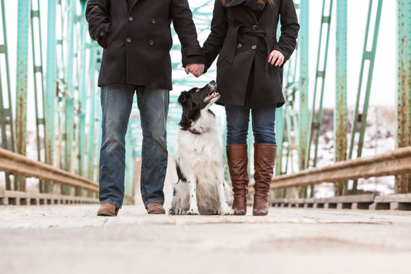 cute-couple-and-dog-on-bridge-Alberta-Canada-