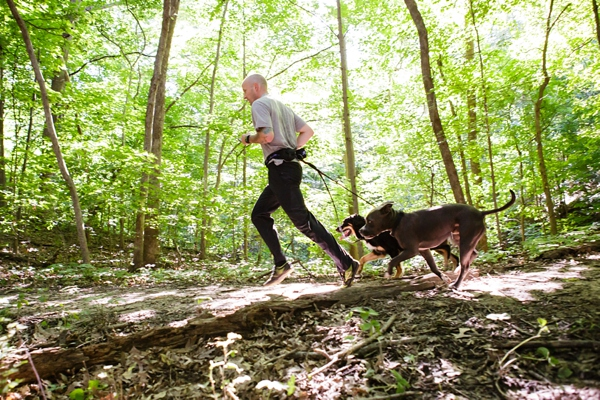 © Jen Madigan Photography, Man-dogs-running-in-woods