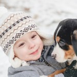 Toddler-and-Swiss-Mountain-Dog-pup