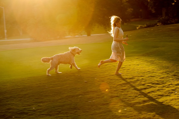 © Eye Wander Photo | girl and her dog, adopt don't shop, fluffy dog playing at park