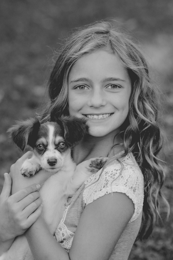 © Paw Prints- Pet Portraits by Charlene | professional portrait of puppy and girl