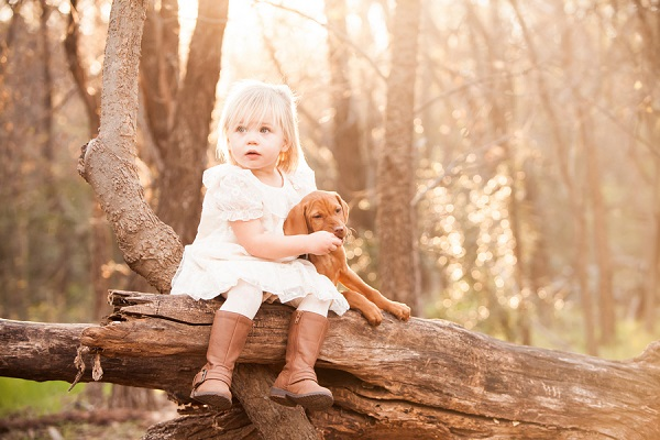 © Fife Photography | little girl and Vizsla puppy, toddler-puppy-sweetest-friendship, on-location-family-portraits-in-woods, Vizsla puppy
