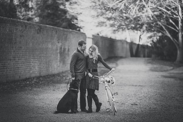 © Imagine It Photography | engaged couple with dog on gravel path, vintage bike, sunflowers, dog, engagement photos