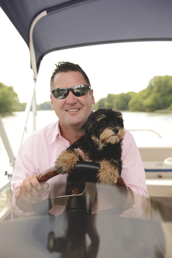 © Ashlee Mintz Photography| Havannese puppy and man on boat, Chester County lifestyle pet photography