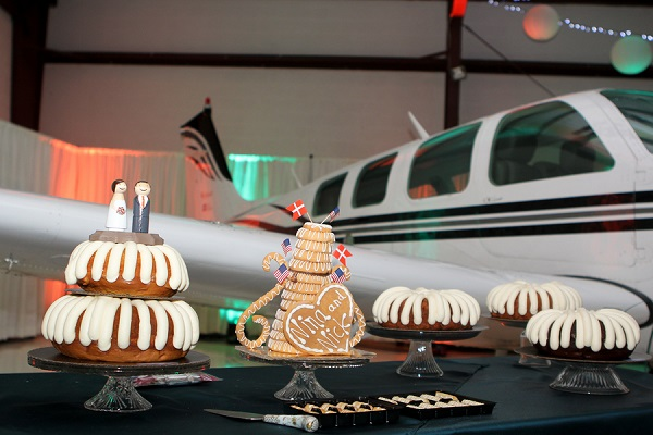 © Love My Life Photography  | wedding reception in airport hangar, cake table