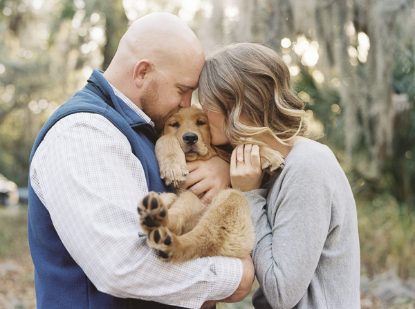 © Emily Katherine Photography Fall Engagement Session, cradling puppy like baby, engagement photos with puppy