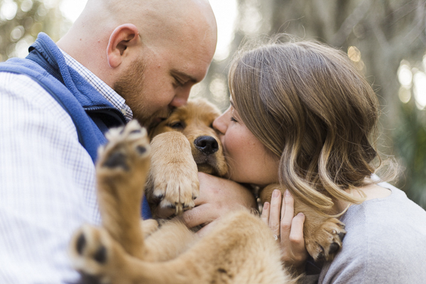 © Emily Katherine Photography | Autumn engagement photos with puppy, cradling puppy, kissing puppy