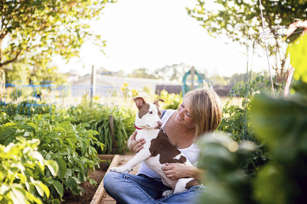 © Jessica Cobb Pet Photography | Lifestyle-dog-photography, girl and her dog, woman and dog in vegetable garden