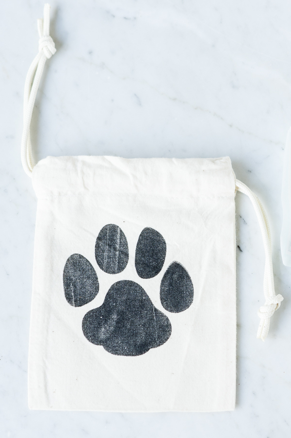 small cloth bag for pet first aid supplies, drawstring bag with paw print