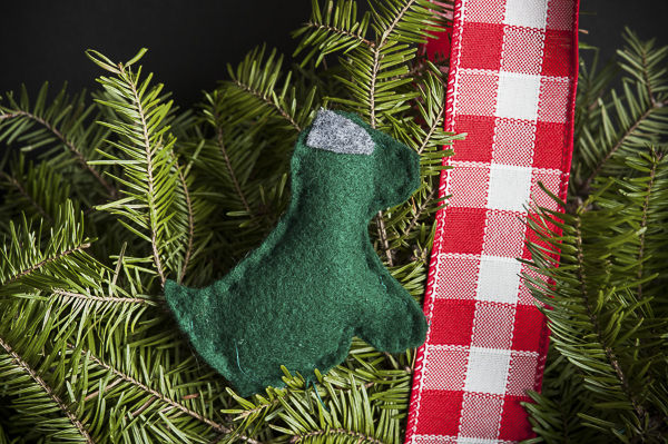 green felt dog on wreath, red gingham ribbon