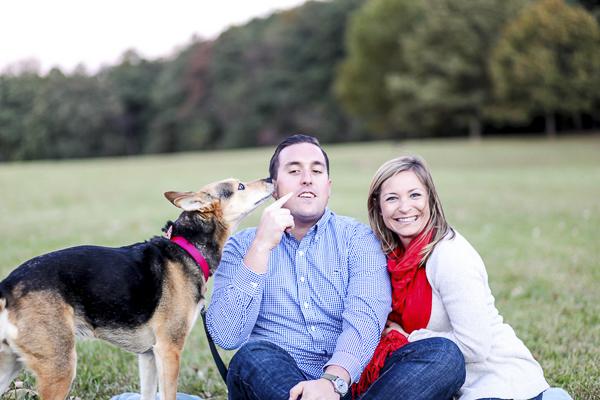 Save the Date photos with dog, Husky/Shepherd mix licking man