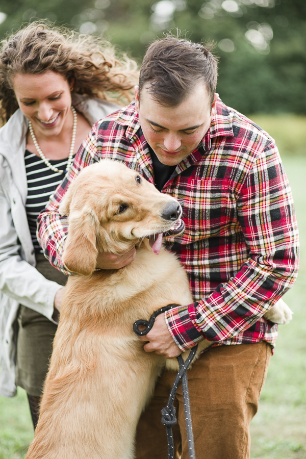 © Tiffany Joyce Photography | man in flannel shirt hugging Golden Retriever puppy, lifestyle dog photos, on location family photography