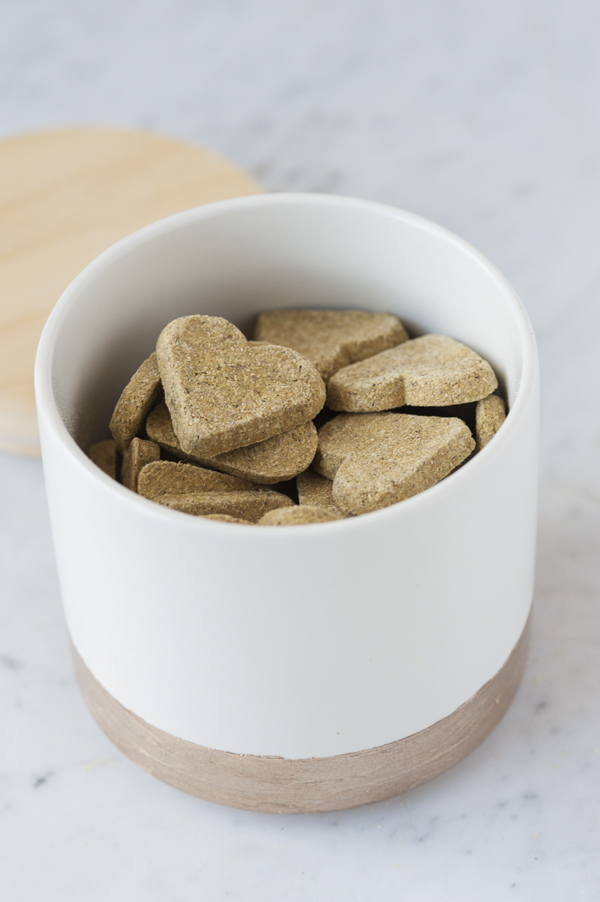 gold band painted ceramic canister with heart shaped dog treats