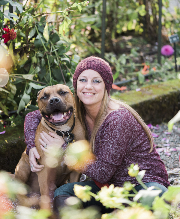 woman hugging happy Pit bull, on location people pet photos