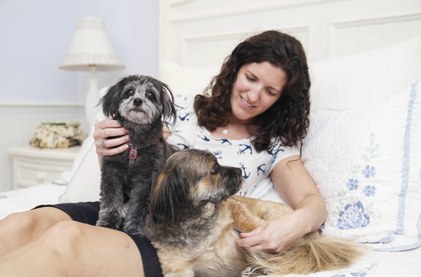 lifestyle-pet-people-photography, woman, dogs on bed