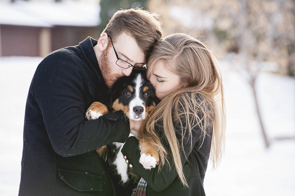 couple kissing puppy, winter dog portraits