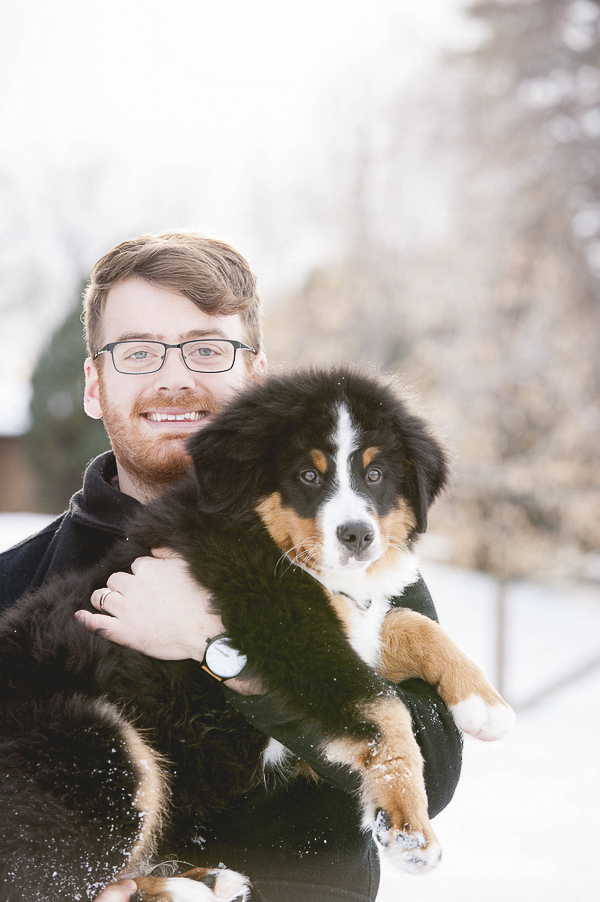 man holding Bernese Mountain Dog puppy