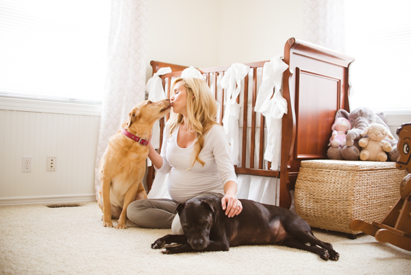 pregnant woman, dogs in nursery