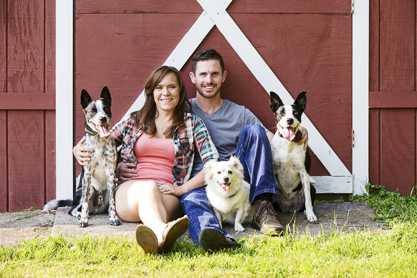 couple, dogs engagement photos red barn door
