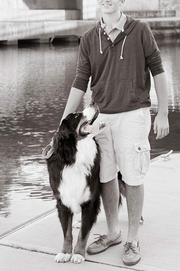 Loyal Bernese Mountain Dog smiling at his teenage boy, lifelong friendship,