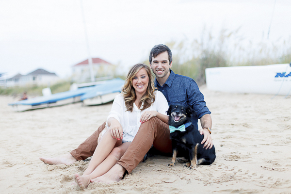 Luke & Ashley Photography, couple and dog sitting on sand beach