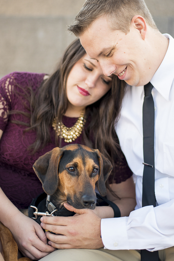 couple dressed for date night with dog, engagement photos