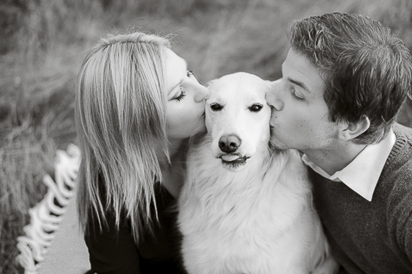 couple kissing dog, Retriever mix, rescue dog