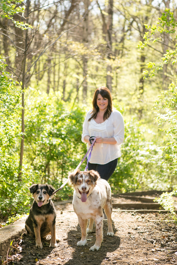 Australian Shepherd mix and mixed breed standing on path with woman, spring pet portraits