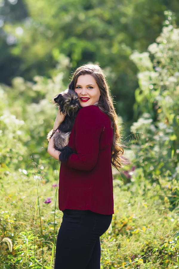 High school senior holding Chihuahua mix, on location senior portraits with dog