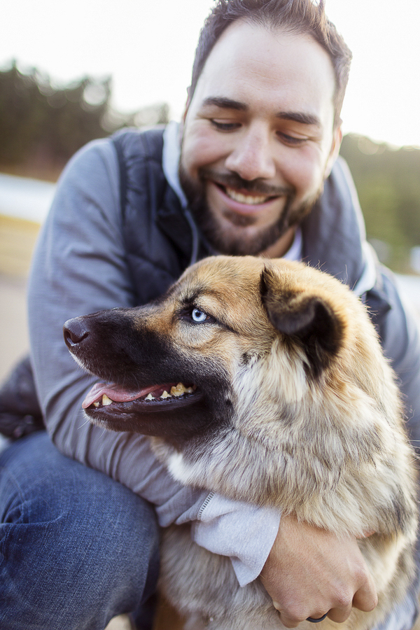 smiling dog, man looking at dog