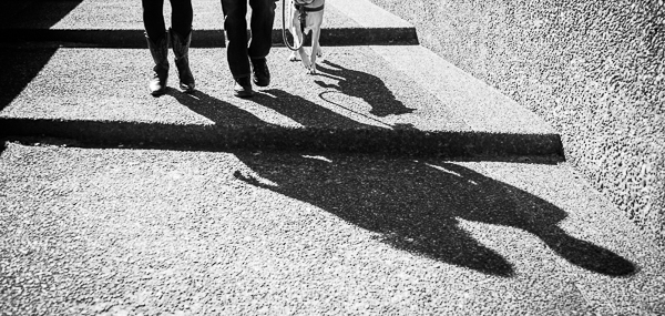 shadows-dog on leash, man, woman