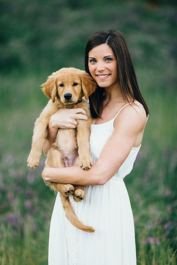 Erin Morrison Photography beautiful brunette in white dress holding Golden Retriever puppy, on location dog portraits
