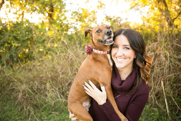 mixed breed dog happy to be held by woman, on location dog portraits