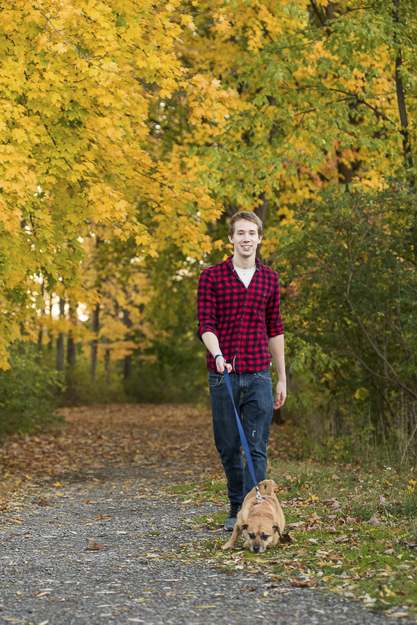 guy in red flannel shirt walking Puggle, fall day in CNY