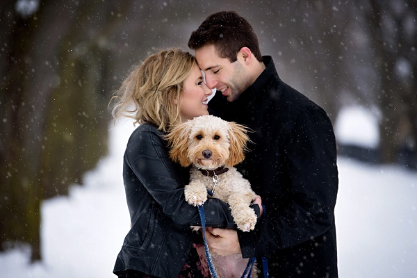 couple nose to nose, holding doodle in snow, winter-dog-portraits-hrmphotography_