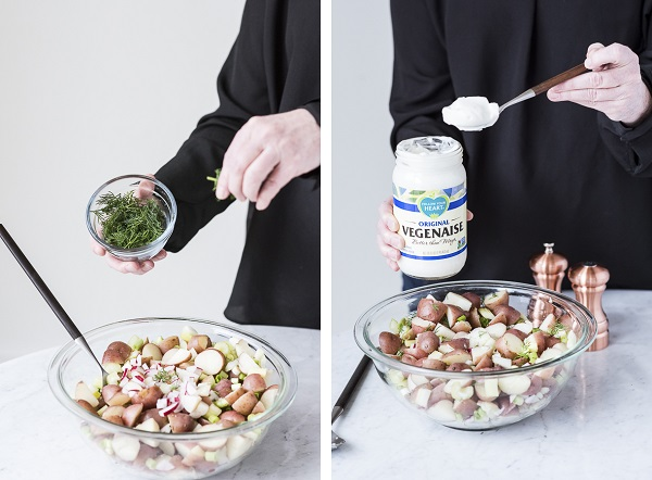 stirring in dill and vegenaise, vegan potato salad