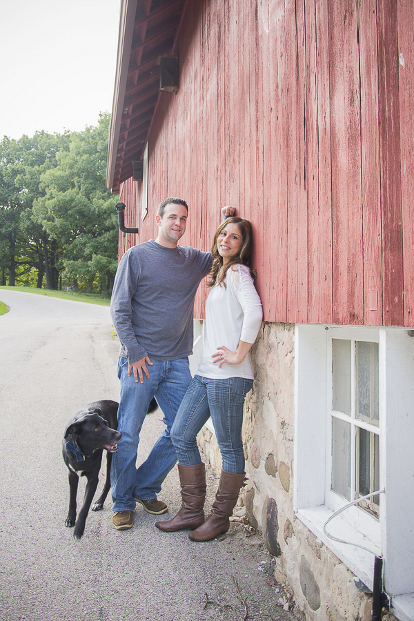 black dog, couple, barn