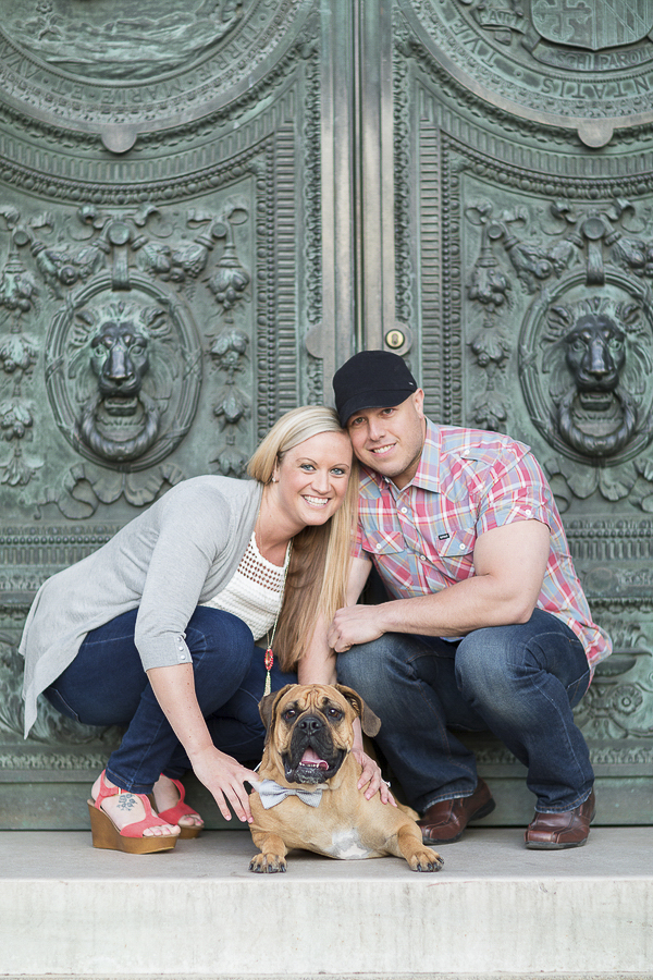 dog lying down, couple in front of green courthouse doors