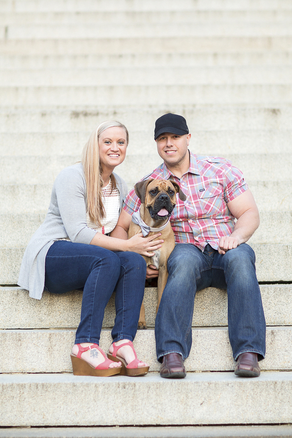 couple and their dog sitting on courthouse steps, engagement photos