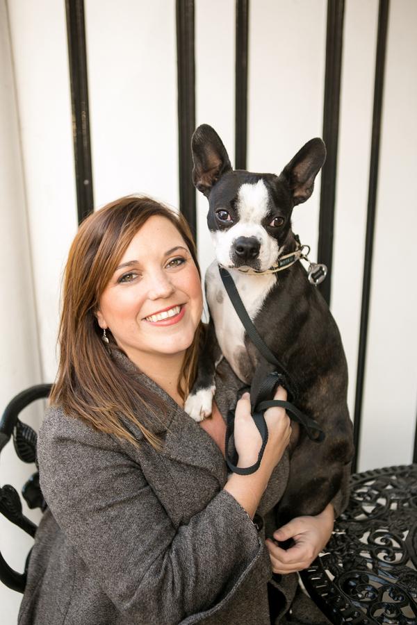 brunette woman holding Boston Terrier,