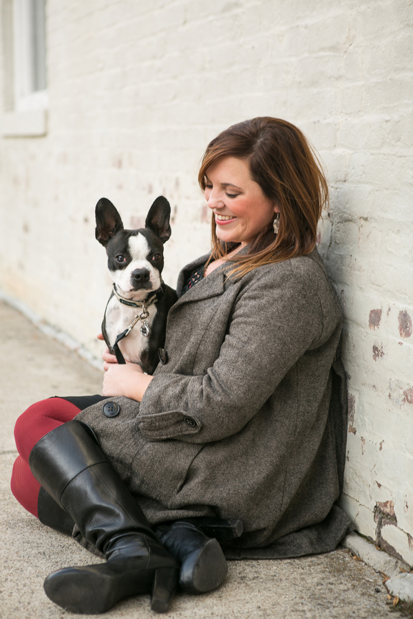 woman smiling at Boston Terrier,