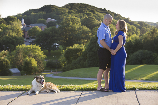Collie-Shepherd mix, pregnant woman in long blue dress, man in shorts, maternity portraits with dog