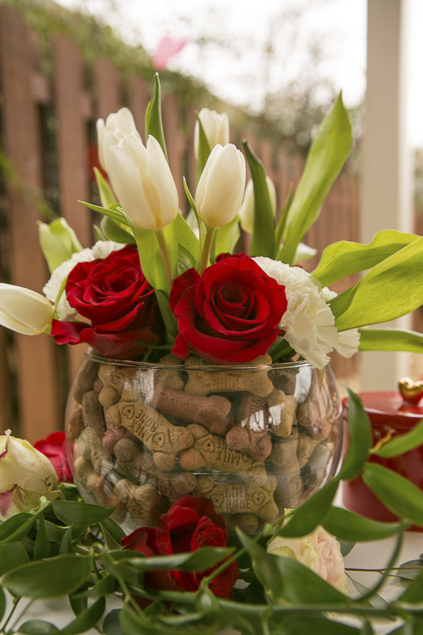 floral arrangement with dog treats in vase