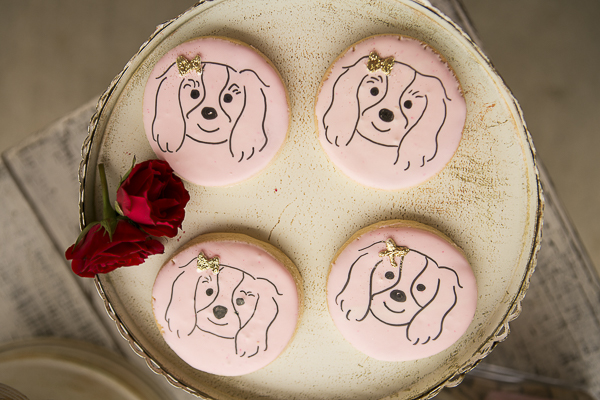 delightful pink cookies with Cavalier design and gold bow