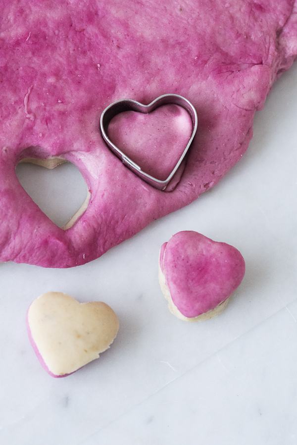 heart cookie cutter in pink dough, beet and banana dog treats tutorial