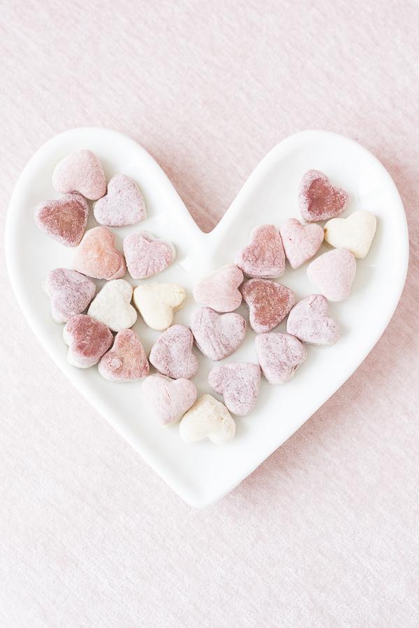heart shaped pink and white dog treats on white heart ceramic plate, banana beet dog treats recipe