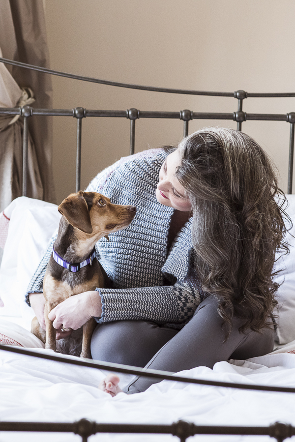 beagle, woman looking at each other, sitting on bed