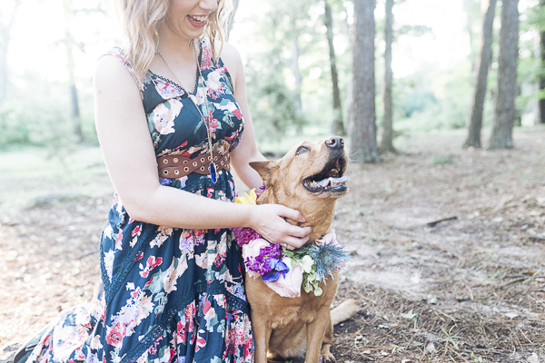 dog wearing flowers, lifestyle dog photography outside in wooded area